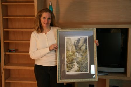 Kathie with her framed Rivendell by Alan Lee